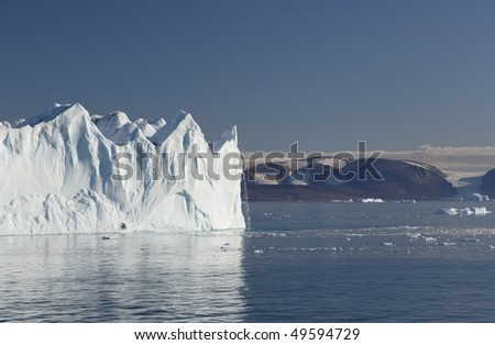 Huge Iceberg with little waterfall in Greenland. Very rare to see. - stock photo