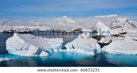 Huge icebergs in Antarctica, blue sky, azure water, sunny day - stock photo