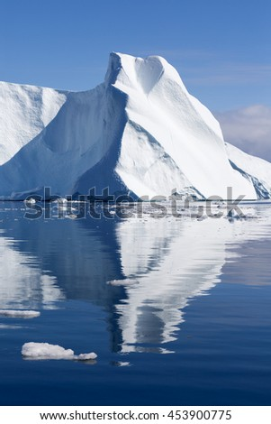Huge icebergs of Greenland.Travel on the scientific vessel among ices. Studying of a phenomenon of global warming. Deep-water fjords with clear water. - stock photo