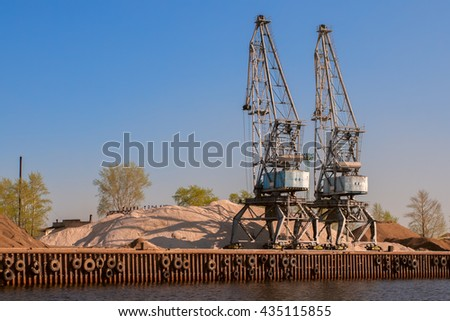 Huge industrial cranes working at the commercial dock, Russia, Kazan - stock photo