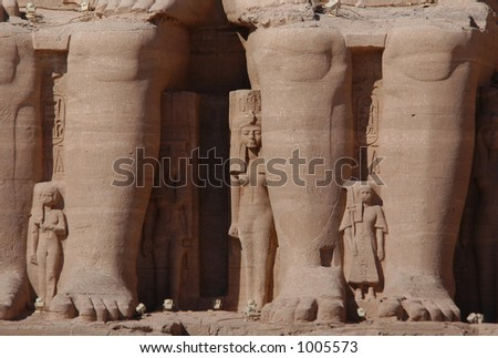 Huge legs of pharaoh Ramses II in front of the Sun Temple of Abu Simbel near Aswan, Egypt - stock photo
