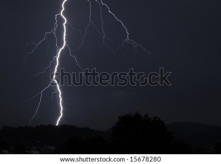 Huge lightning bolt striking in Beskydy mountains, Czech Republic - stock photo