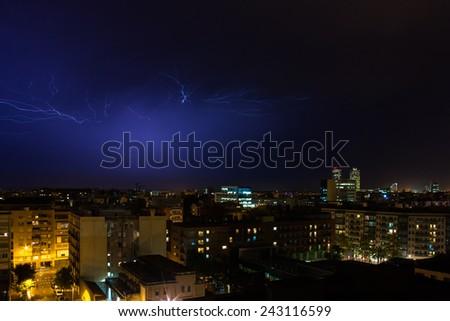 Huge lightning storm over the city. Barcelona, Spain - stock photo