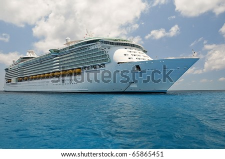 huge luxury cruise ship anchored in blue caribbean waters - stock photo
