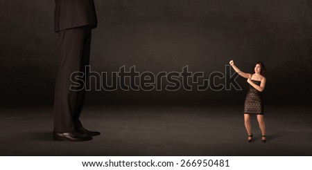 Huge man with small businesswoman standing at front concept on background - stock photo
