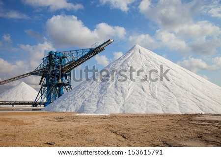 Huge mounds of extracted sea salt - stock photo