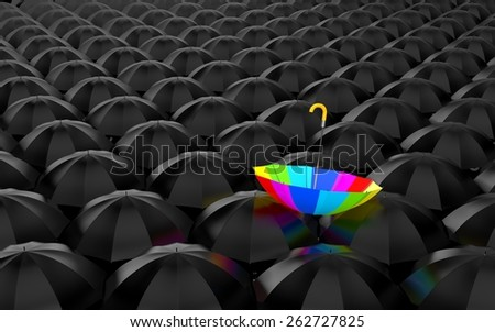 Huge number of open black umbrellas, on top of which lay a rainbow umbrella - stock photo
