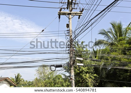 Huge number of power lines orderly running along a street in nearby Bangkok, Thailand