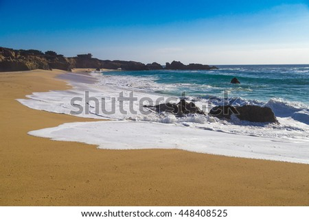 Huge ocean waves crushing on rocks in Garrapata State Beach in California, USA - stock photo