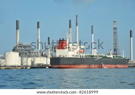 Huge Oil Tanker Docked At  An Offshore Oil Refinery - stock photo