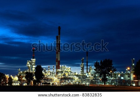 Huge panorama shot of big oil-works in night lights. - stock photo