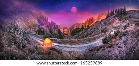 Huge picturesque loop of the old rural road goes around the Carpathian mountain pass, hitting the viewer views frosty slopes of the Alps Ukrainian Pristan for winter wanderers frosted path - stock photo