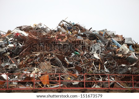 Huge pile of assorted industrial junk or waste including metal and plastics waiting to be disposed of safely without causing pollution - stock photo