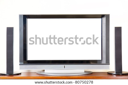 Huge Plasma / LCD TV with surroundsound system, blank screen for copyspace - stock photo