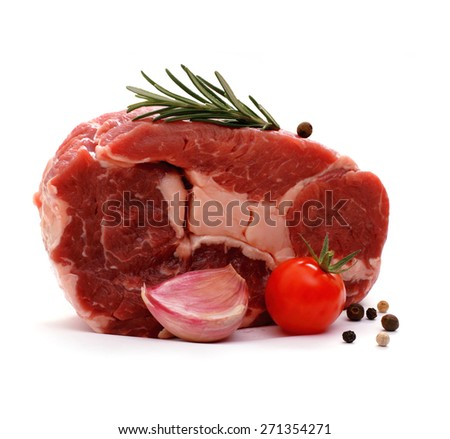 Huge raw ribeye steak garnished with spices, isolated - stock photo