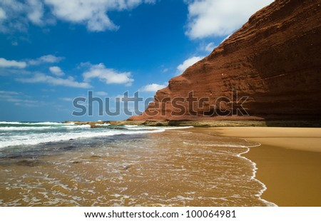huge red cliffs on the beach Legzira. Morocco - stock photo