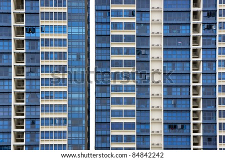 Huge resident apartment building with blue glass - stock photo