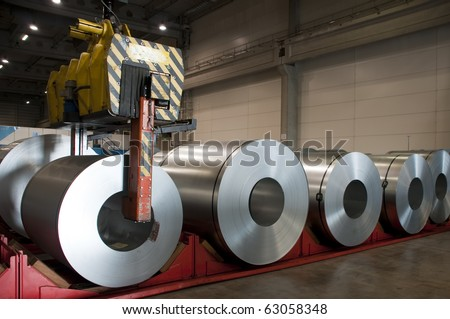 Huge rolls of tinplate in the factory - stock photo