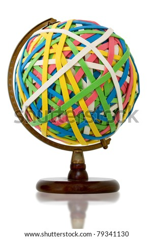 Huge rubber band ball held on wooden globe stand. - stock photo