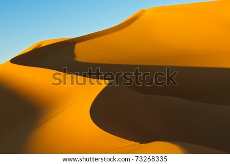 Huge Sand Dune at Sunset in the Awbari Sand Sea, Sahara Desert, Libya - stock photo