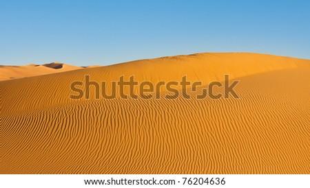 Huge sand dunes with rill patterns - Awbari Sand Sea, Sahara Desert, Libya - stock photo