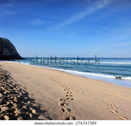 Huge sandy beach on the Atlantic coast of Portugal. Early morning - stock photo