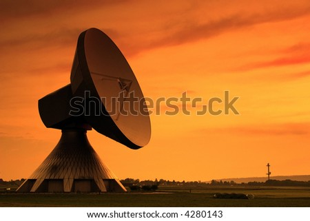 Huge Satellite Dish in the Evening Sun - stock photo