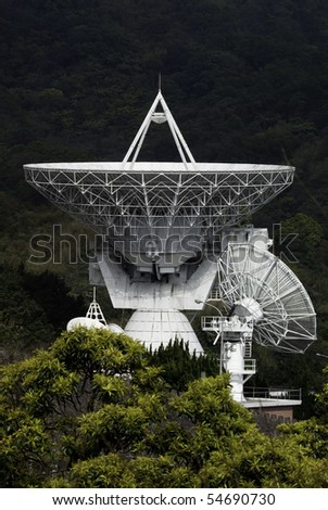 huge satellite dish receiving or broadcasting signals - stock photo