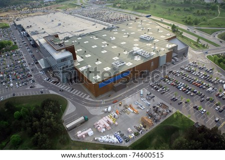 Huge shopping mall of household goods with a lot of parking space, aerial view - stock photo