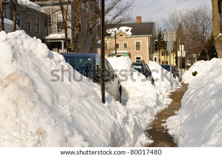Huge snow piles on city street - stock photo