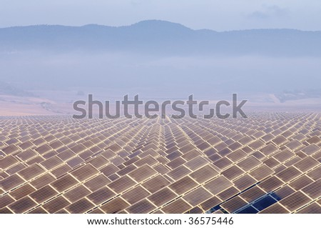 huge solar field in the morning - stock photo