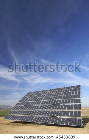 huge solar panel and blue sky - stock photo