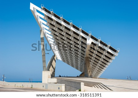 Huge Solar Panel in the harbor Port Forum in the north of the district Poblenou in north of Barcelona. The old industrial estate was rebuild with a new port, technology, buildings and museums - stock photo