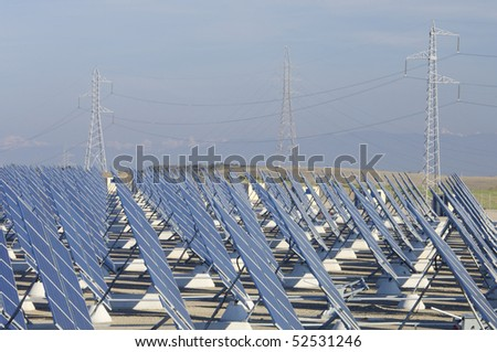 huge solar station and high tension towers - stock photo