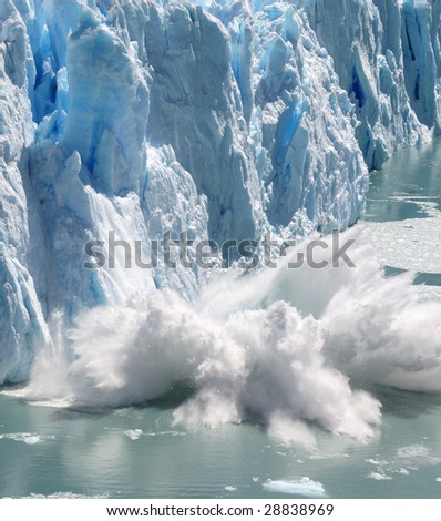 Huge stack of ice collapsing off the Perito Moreno Glacier, Patagonia, Argentina. - stock photo