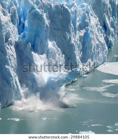 Huge stack of ice collapsing off the Perito Moreno Glacier, Patagonia, Argentina. Three of a series of four. - stock photo