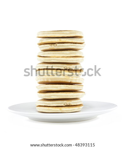 huge stack of pancakes isolated on white background