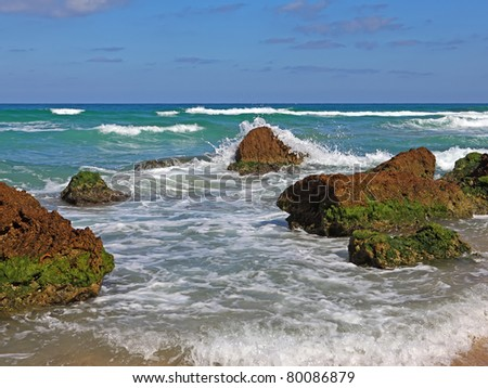 Huge stones in surf waves. Picturesque coast Mediterranean sea,Netanya, Israel