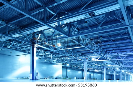 Huge storehouse toned in the blue color - stock photo