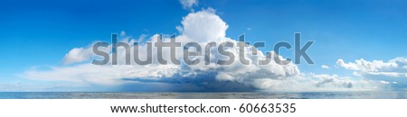 Huge storm cloud over the sea - stock photo