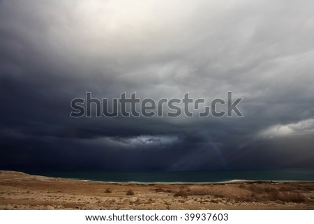 Huge thundercloud above an autumn field in state of Montana