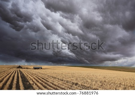 Huge thundercloud on fields of Montana - stock photo