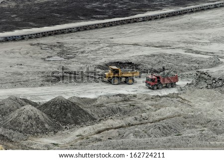 huge truck on a coal mine open pit - stock photo