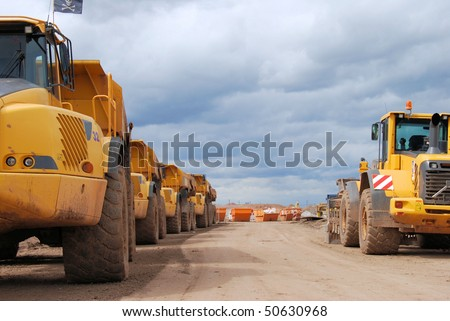 Huge trucks on a construction site