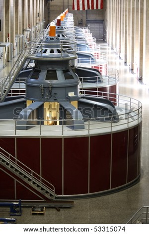 Huge turbines in a row inside of Hoover Dam. - stock photo