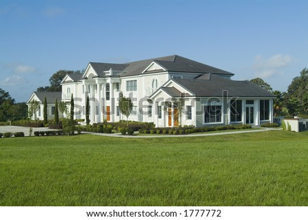 Huge upscale American house/mansion with beautiful landscaping
