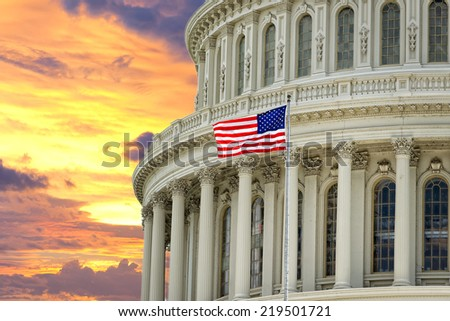 Huge view Panorama of Washington US Capitol on dramatic sunset gold background - stock photo