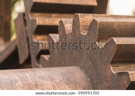 Huge vintage  gear wheel in colonial factory  - stock photo