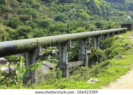 huge water pipe on hill - stock photo