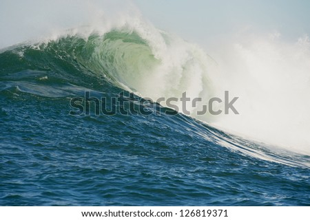Huge wave breaks during the Maverick Invitational surfing competition at Half Moon Bay California - stock photo